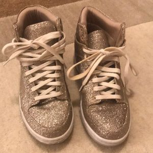 Glittery gold high top sneakers